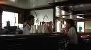 Stock Video Footage of Vietnamese cruise ship bar employees