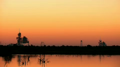 NASA launch pads at sunrise from distance Stock Footage