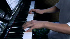 Young boy playing the piano Stock Footage