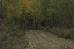 SUV On Dirt Road Stock Footage