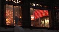 Stock Video Footage of Buddhist Temple through windows