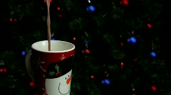 Hot Cocoa with marshmallows in front of Christmas tree Stock Footage