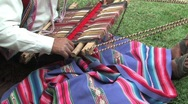 Stock Video Footage of Man weaving a rug in Peru
