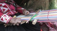 Stock Video Footage of Woman weaving a rug in Peru