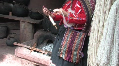 Woman spinning wool, Peru - stock footage