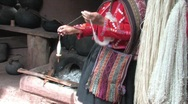 Stock Video Footage of Woman spinning wool, Peru