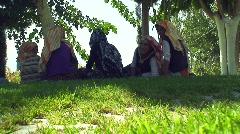 Turkish women taking shade Stock Footage