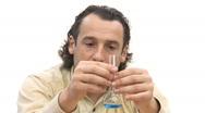 Stock Video Footage of student studies properties of liquid.