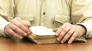 Man reads old book. Stock Footage