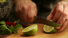 Chef slices lime Stock Footage