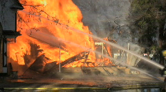 House fire and firefighters Stock Footage