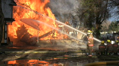 House fire with falling debris - stock footage