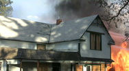 House fire-flames, smoke and debris Stock Footage