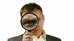 Businessman with magnifier face Stock Footage