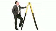 Businessman with stepladder Stock Footage
