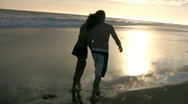 Stock Video Footage of A cute young couple, enjoying a beautiful day at the beach.