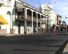 The Casa del Hierro in Iquitos, Peru with moto-taxis in foreground Stock Footage