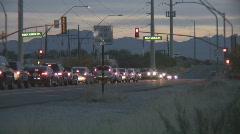 Dusk suburban traffic medium speed time lapse Stock Footage