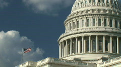 Stock Video Footage of US Capitol Building and American Flag