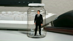 Businessman in a jar Stock Footage