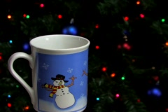 Serving cocoa in front of Christmas tree Stock Footage