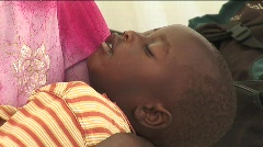 WOMAN WITH CHILD IN KENYA IDP CAMP Stock Footage