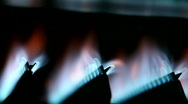 Stock Video Footage of On / Off cycle of a gas furnace burners