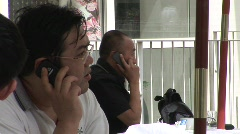 Chinese men talking on cellphones, Beijing Stock Footage