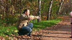 little girl run to senior in autumn park - stock footage