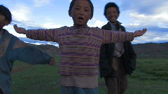 Children dancing and singing in Tibet. - stock footage