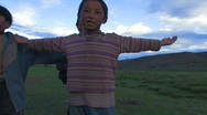 Stock Video Footage of Children dancing and singing in Tibet.