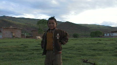 A child dancing and singing in Tibet. Stock Footage