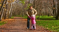 Stock Video Footage of grandfather rotate child in autumn park