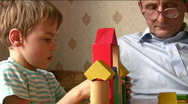 Stock Video Footage of child with senior built toy house