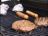 Burgers, Brats, and Chicken on Grill Stock Footage