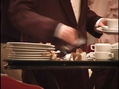 Stock Video Footage of Busboy Removes Dirty Plates