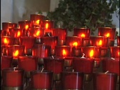 Stock Video Footage of Candles in Catholic Church 1