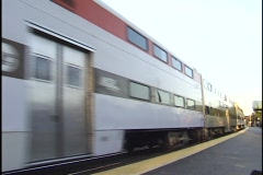 Commuter Train Passes Station Stock Footage
