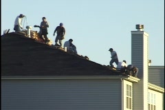 Construction Workers on Roof 1 Stock Footage