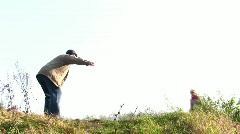boy run to senior in autumn park - stock footage
