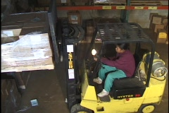 Stock Video Footage of Forklift Operator Placing Skid 3