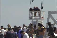 Lifeguards Watch People on Beach Stock Footage