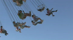 Kids on carnival swing M H Stock Footage