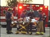 Paramedics Treat Woman on Gurney 1 Stock Footage