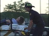 Paramedics Treat Woman on Gurney 3 Stock Footage