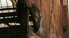 Rusty warehouse door swinging in the wind Stock Footage