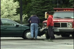 People Inspecting Car Accident Stock Footage