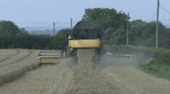 Stock Video Footage of New Holland combine harvester working - rear.