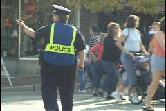 Police Directing Traffic and People 2 Stock Footage