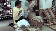 Stock Video Footage of Woman spinning wool